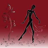 graceful girl in a transparent dress walking on the leaves. Black and white graphics on a red background