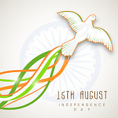 Beautiful flying pigeon with national flag color waves on ashoka wheel background for 15th of August, Indian Independence Day celebrations.