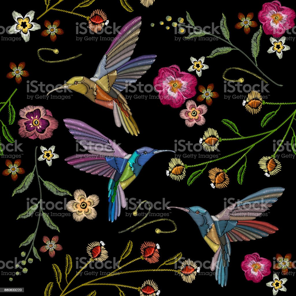 Beautiful hummingbirds and exotic flowers embroidery on black background. Template for clothes, textiles, t-shirt design. Humming bird and tropical flowers embroidery seamless pattern vector art illustration