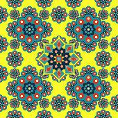 Beautiful mandala pattern with islamic geometric flower seamless on yellow color background.