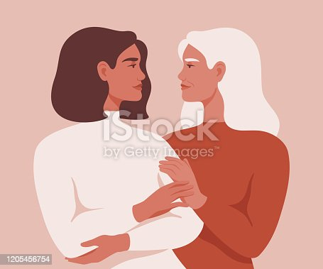 istock Beautiful senior mother and her adult daughter are embracing and looking at each other in the face. 1205456754