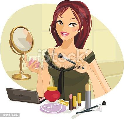 istock Beautiful Woman doing her Make-up 483991497