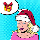 Beautiful woman in Santa Claus hat in the pop art comics style. The girl dreams of a gift.