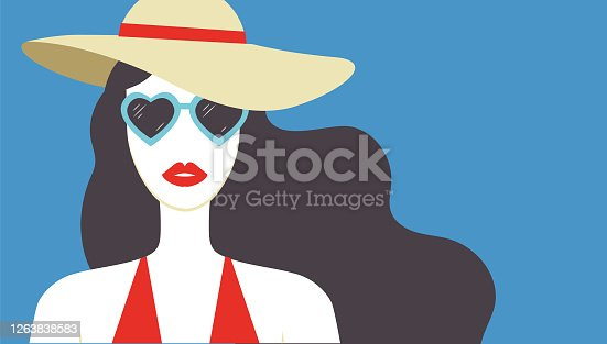 istock Beautiful young woman with red lips wearing hat and heart shaped sunglasses. Summer fashion poster. - Vector 1263838583