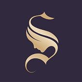 Golden decorative lettering icon with female portrait silhouette