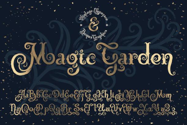 """wunderschöne dekorative schriftart namens """"magic garden"""" mit effekt """"schön strukturierte störung"""". - steampunk stock-grafiken, -clipart, -cartoons und -symbole"""