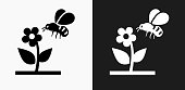 Bee on Flower Icon on Black and White Vector Backgrounds. This vector illustration includes two variations of the icon one in black on a light background on the left and another version in white on a dark background positioned on the right. The vector icon is simple yet elegant and can be used in a variety of ways including website or mobile application icon. This royalty free image is 100% vector based and all design elements can be scaled to any size.