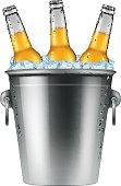 Beer bottles in an ice bucket.