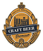 Template beer label with wheat or barley ears, hops, crown and with image of the building of the old brewery in oval frame. Vector label for craft beer in retro style in form of coat of arms