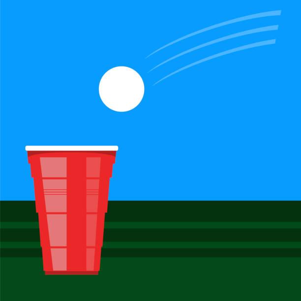 bier pong turnier. roten plastikbecher und weißen tennisball am grünen tisch. lustiges spiel für party - hochschulgetränke stock-grafiken, -clipart, -cartoons und -symbole