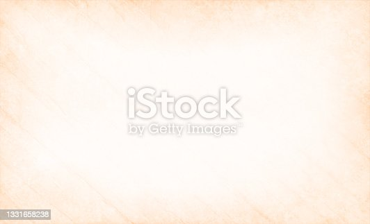 istock Beige coloured grunge textured vintage paper textured backgrounds with diagonal scratches all over and a bright centre 1331658238