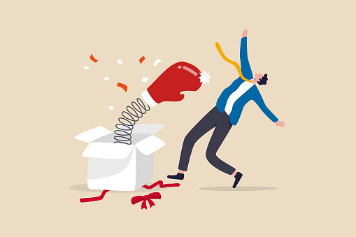 Being fired from job, unemployment and jobless, business failure or stock market bad news surprise investor concept, businessman open present box with surprise boxing glove punching knock out.