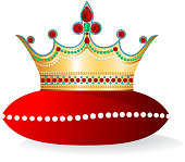 The golden crown is decorated with diamands, rubis and other stones. It rests on a pillow that is decorated with pearls.