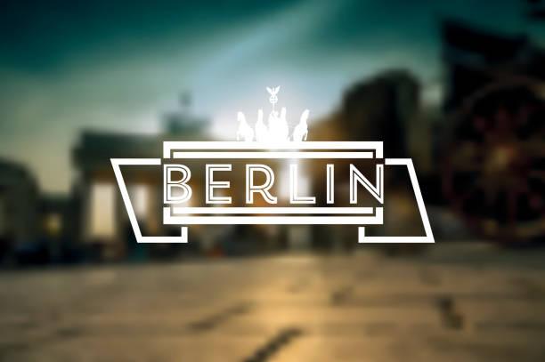 berlin linie text-symbol auf verschwommene hintergrund - berlin brandenburger tor blurred stock-grafiken, -clipart, -cartoons und -symbole