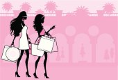 Two women shopping on Rodeo Drive in Beverly Hills. Click below for more fashion and shopping images
