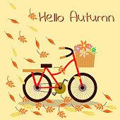 Bicycle and flower basket in autumn season background