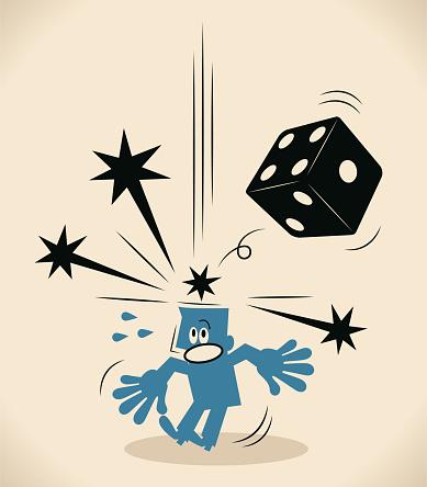 Big dice falling and hitting businessman's head
