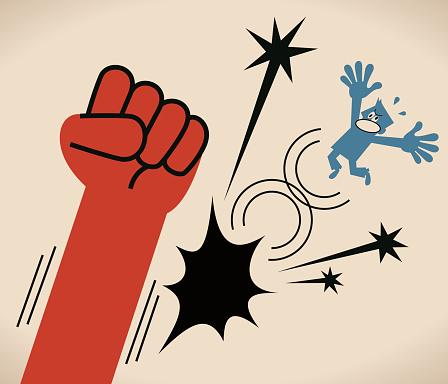Big fist knocks down a business person