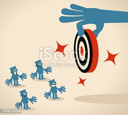 istock Big hand gives group of people (team members, businessmen) a new goal (dart board, target). Leadership is all about helping them to grow to their fullest potential, and motivating them to work toward a common goal 1270172208