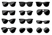 istock Big set of fashionable black sunglasses on white background. Black glasses isolated with shadow for your design. 1141907495