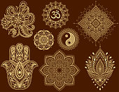 Big set of Mehndi flower pattern, mandala, mantra OM, Yin-yang symbol and Hamsa for Henna drawing and tattoo. Decoration in ethnic oriental, Indian style.