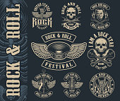 Big set of vintage rock and roll emblems on dark background. Perfect for the shirt designs and many other. Text is on the separate group.