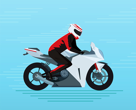 Biker in a protective suit and helmet rides a sports bike.