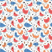 istock Bird seamless pattern with funny character. Vector illustration ready for fashion textile print. Trendy hand drawn for baby and kids apparel. Blue and orange colors. 1253786632