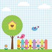 Birds and birdhouse on tree