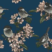 A seamless repeating pattern of adorable black-capped chickadees perched on fruit blossom trees.