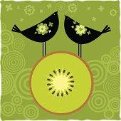 Two birds on a sliced kiwi.