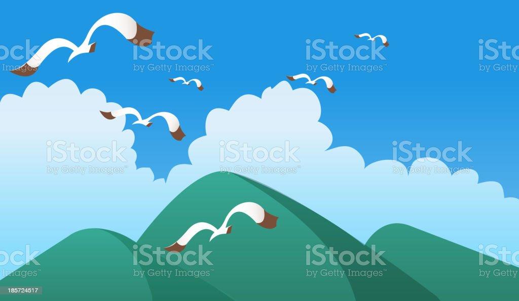 Birds flying over green mountain