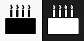 Birthday Cake Icon on Black and White Vector Backgrounds