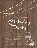 Birthday party string lights and rustic wooden background design invitation template. Easy to edit with layers. Includes placement sample text and sparkles and elegant glass canning jar.