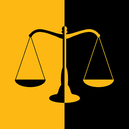 Black And Gold Scales Of Justice Icon.