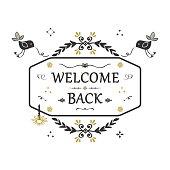 Black and golden hand drawn Welcome Back floral emblem banner on white background
