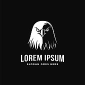 Black and white eagle head vector icon template on black background