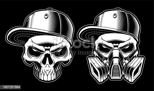Black and white graffiti skulls on dark background.