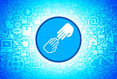 Black and White Hands Touching Icon on Internet Technology Background. This image features the main icon on a blue round button. The vector button is surrounded by a seamless pattern of internet and modern technology icons. The icons vary in size. There is a glow effect around the button. Icons include such technology elements as computer, email, internet, communications and many more. The image is predominantly blue in color.
