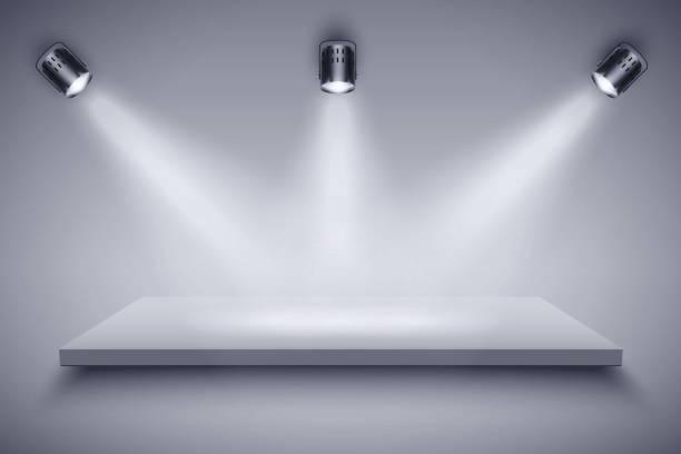 Black and white Presentation platform Light box with Black and white platform on with three spotlights. Editable Background Vector illustration. showroom stock illustrations