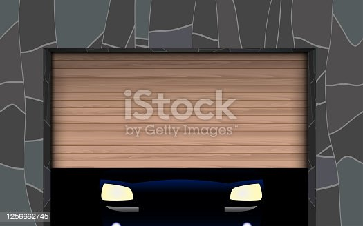 light of a car in wooden garage