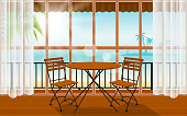 wood table and chair in indoor cafe and restaurant with the beach background
