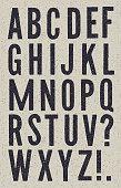 istock Black and White vintage newspaper alphabet 1207269601