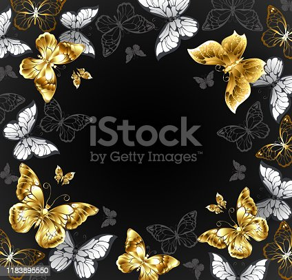 Black background with gold jewelry and white butterflies. Golden butterfly.