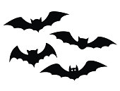 Black bats set on a white background