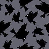 Black birds silhouette seamless pattern.