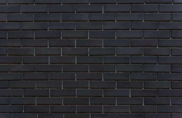 Black brick wall textured background vector art illustration