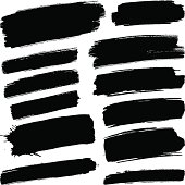 Various black brush strokes on a white background.