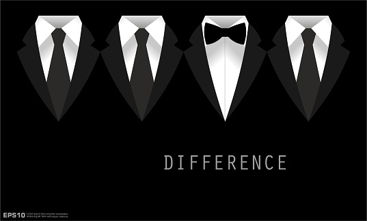 Black Business Suit with a Tie and Bow Tie Difference Concept
