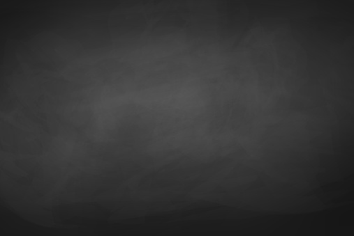Black chalkboard background.
